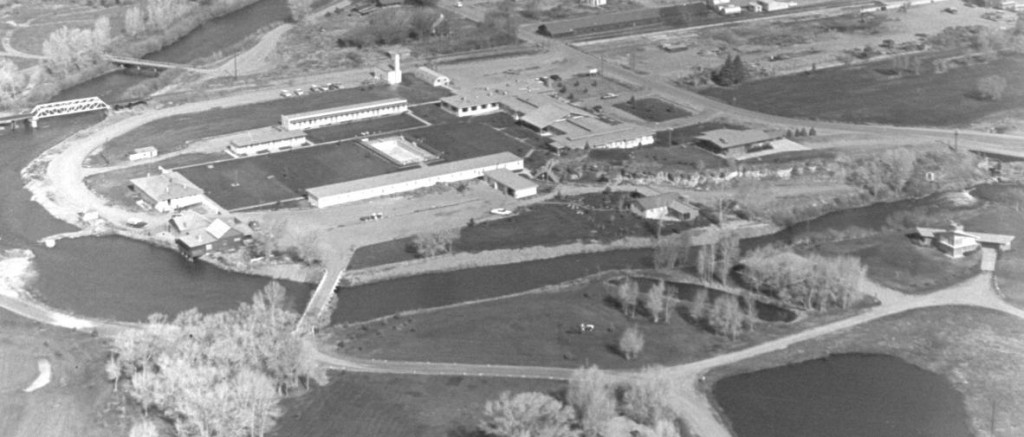 Aerial view of the Saratoga Inn taken by Dick Perue in the 1960's which shows the hotel and units, swimming pool, bath house, state cottages, part of holes number one and nine of the golf course, driving range, private homes and building sites, and surrounding land.